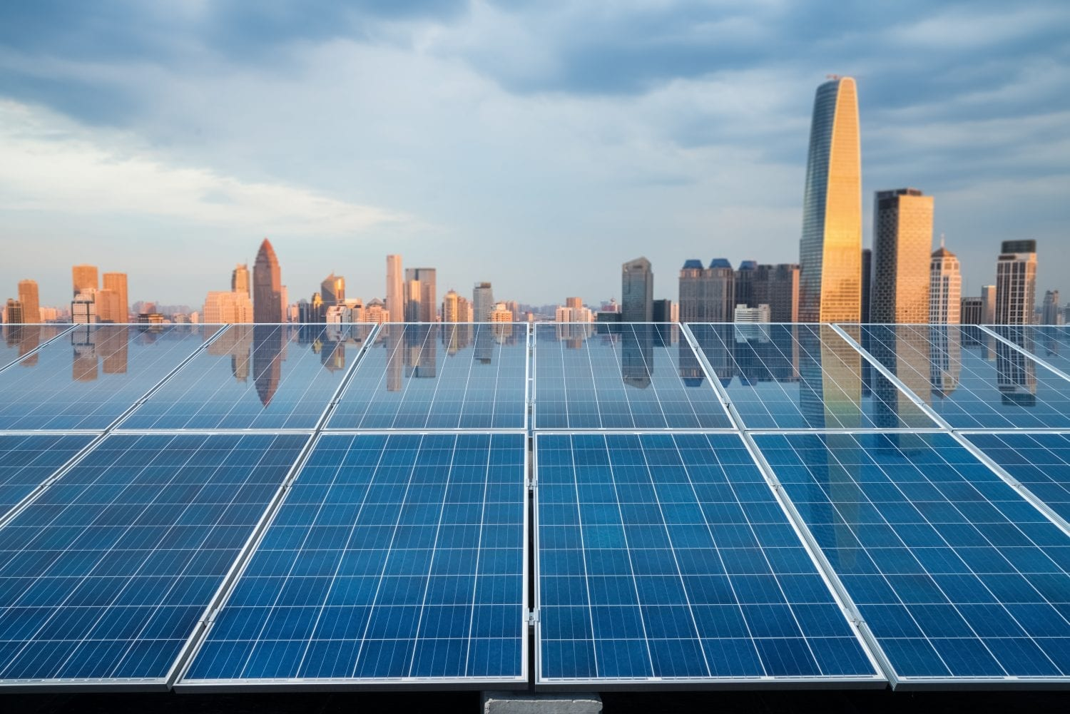 Rooftop solar panels city reflection
